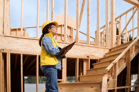 Female builder wearing hard hat