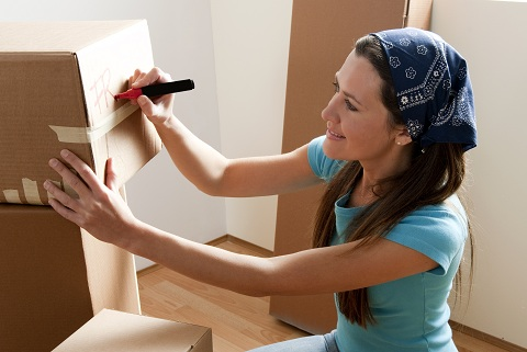 Make the Move_Woman Labeling Packed Box_shutterstock_66379999.jpg