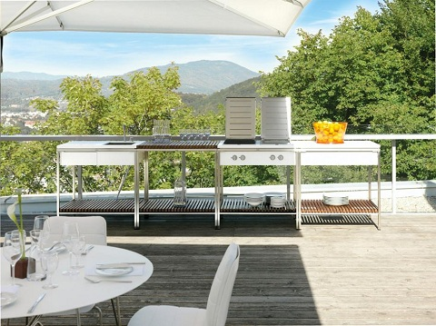 An outdoor modular kitchen allows outdoor cooking enthusiasts to mix ...