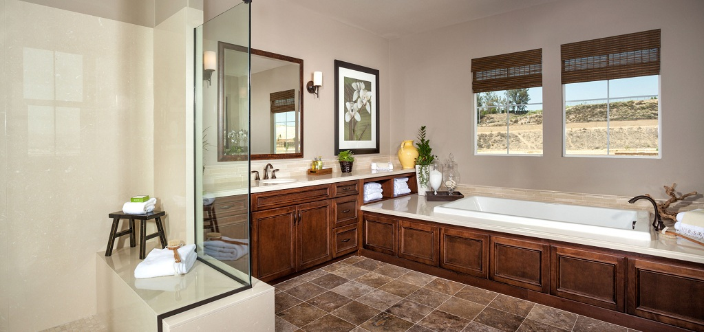 Home of the week residence three by kb home for Pictures of master bathrooms in new homes