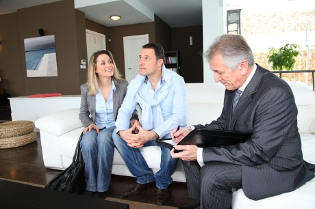 Realtor Sitting with Couple