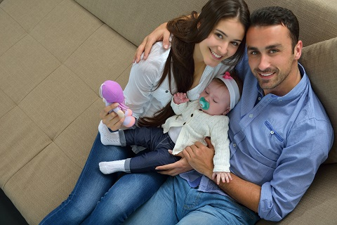 Couple with Baby Inside Home