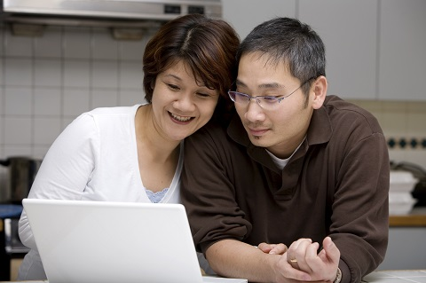 Couple looking at laptop.