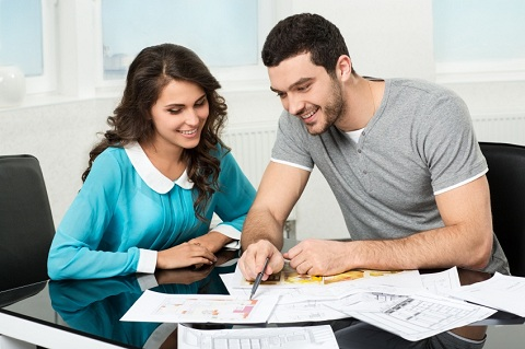 Couple Looking at Floor Plans